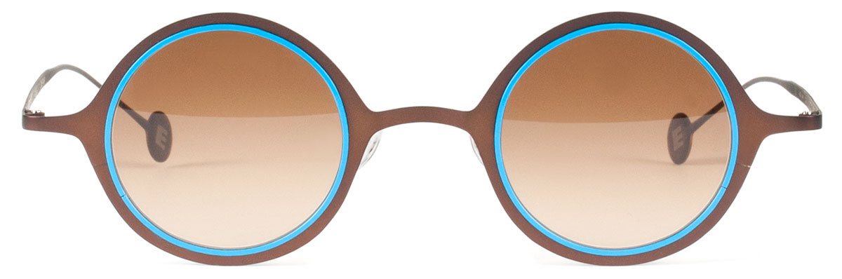 27a30f7507 This DONUT is a marvel of color and craftsmanship in ultra-thin stainless  steel with precision honed lens inserts.